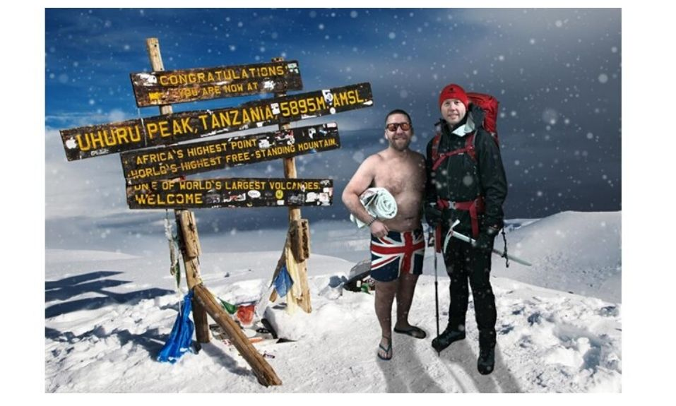 John & Steve atop of Mount Kilimanjaro